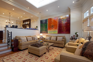 traditional-living-room-sunken-living-room-pictures-art-painting-abstract--bright-colors-french-tan-sofa